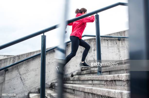 Woman Running Up The Stairs