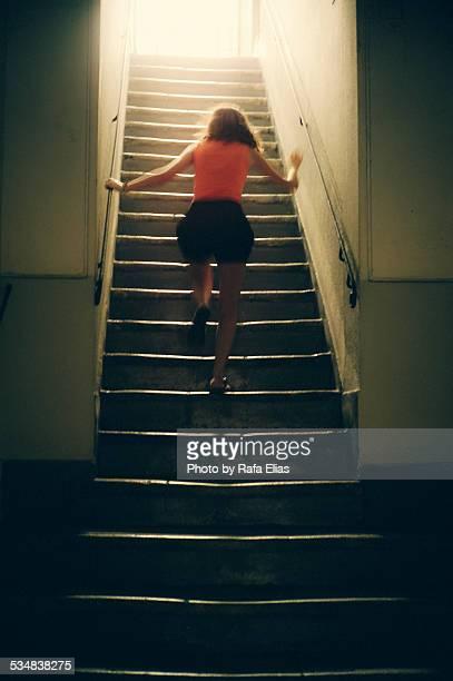 Woman running upstairs