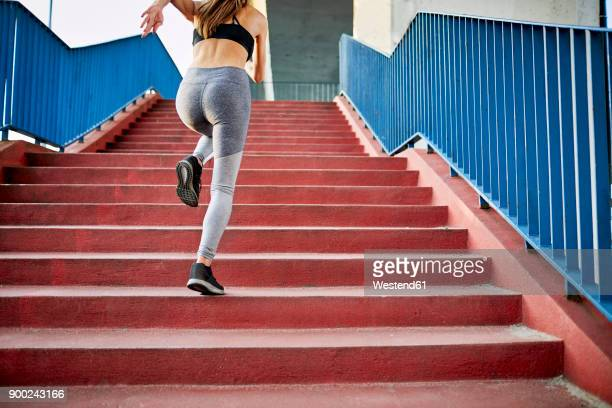 woman running upstairs - sprinting stock pictures, royalty-free photos & images