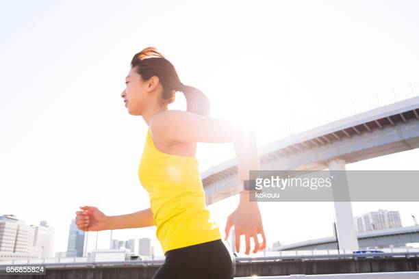 A woman running with a smile