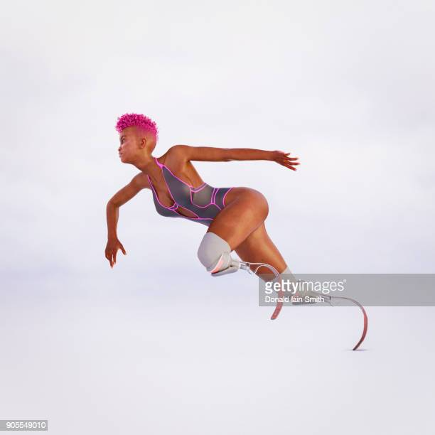 woman running with artificial legs - amputee woman stock-fotos und bilder