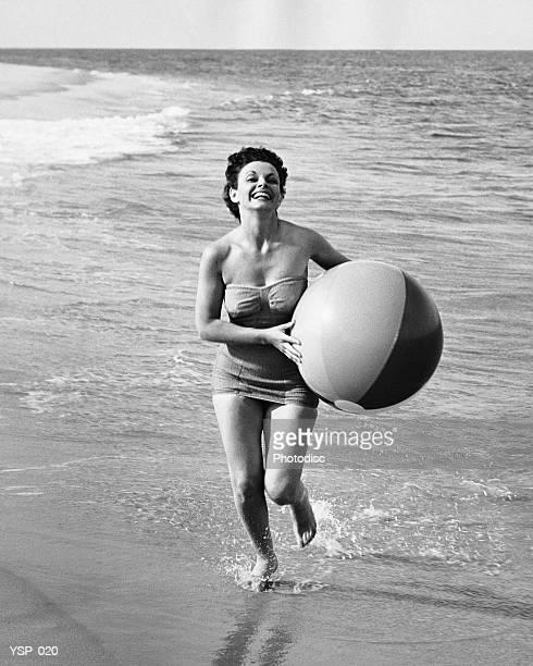 Woman running with beach ball