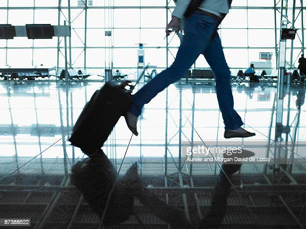 woman running with suitcase