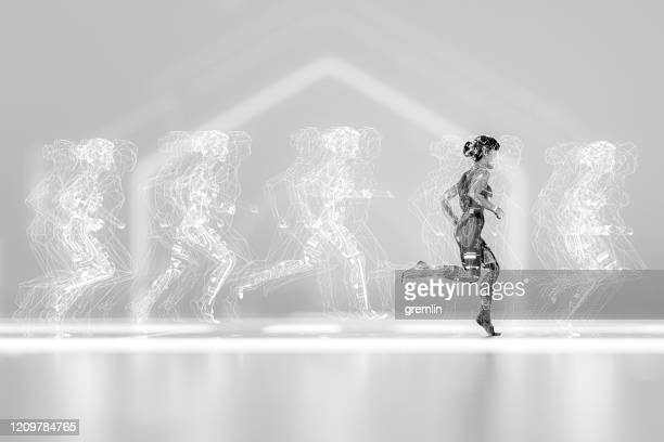woman running with various data screens - scrutiny stock pictures, royalty-free photos & images