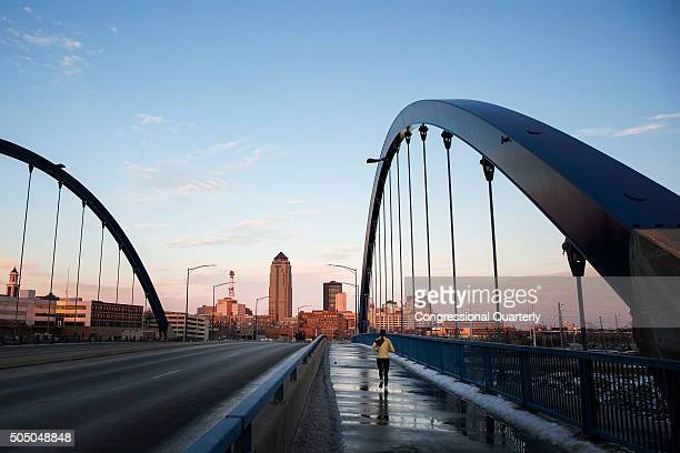 STATES JANUARY 14 A woman runs across a bridge on West Martin Luther King Jr Parkway as the sun sets in Des Moines Iowa Thursday Jan 14 2016