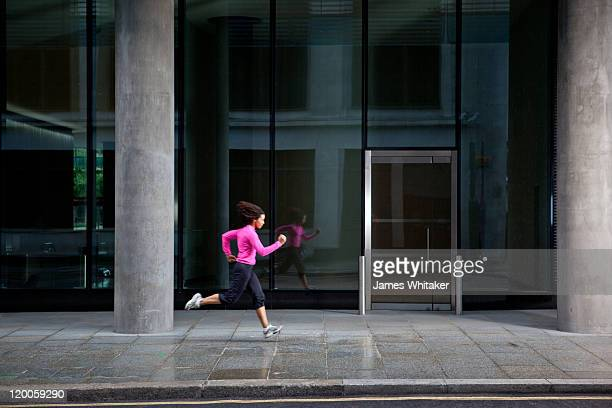 Woman runs past office door