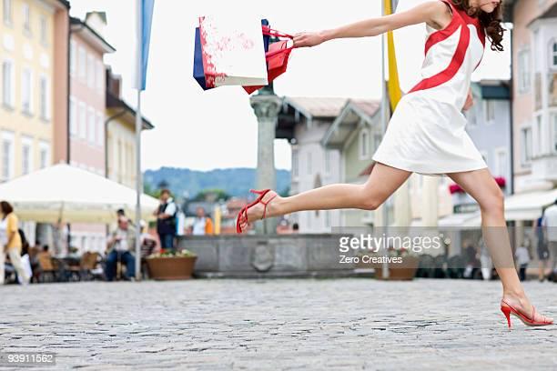 woman runs through a shopping street