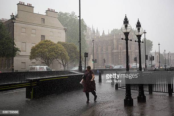 A woman runs through heavy rain in Westminster on June 8 2016 in London England The Met Office has issued flood alerts for parts of the south east of...