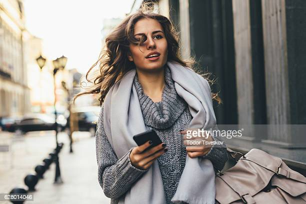 woman rushing down the street - a fall from grace stock pictures, royalty-free photos & images