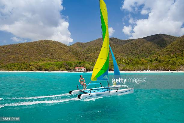 woman sailing a catamaran in cinnamon bay, st.john, usvi - catamaran sailing stock photos and pictures