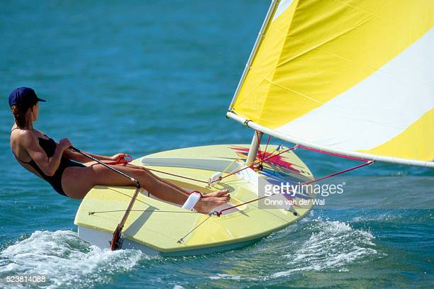 woman sailing a sunfish - sunfish stock pictures, royalty-free photos & images
