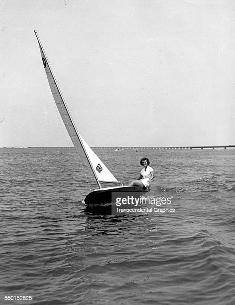 A woman sails a small sailboat alone Ocean City New Jersey 1940