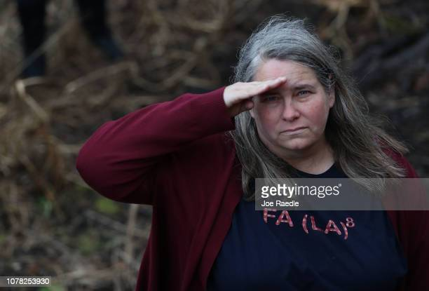 A woman salutes as the train carrying former President George HW Bush to his final resting place passes by on December 6 2018 in Texas President Bush...