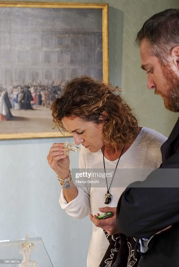 A woman samples different fragrances during the press preview of the perfume exhibition on October 29, 2013 in Venice, Italy. The new perfume section at the Venetian Museum of eighteenth-century lifestyle Palazzo Mocenigo will open on the 1st of November.