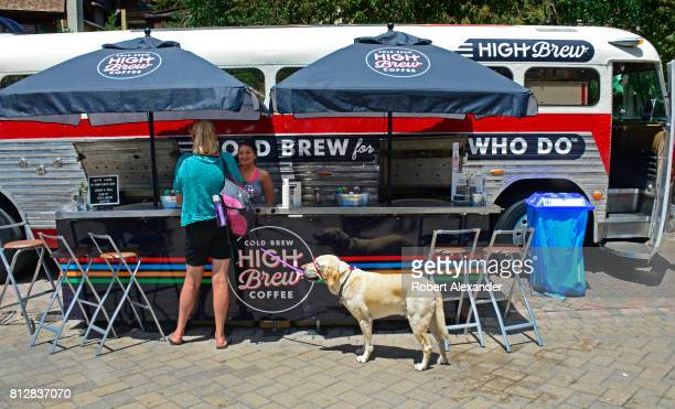 A woman samples High Brew Coffee at the company's mobile vintage bus marketing display in Vail Colorado The coldbrew coffee company is based in...