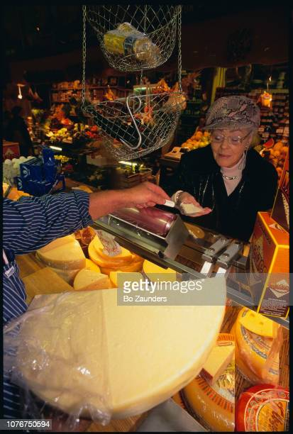 Woman Sampling Cheese