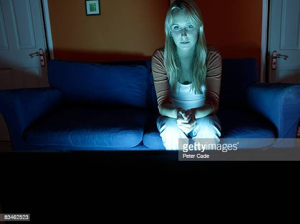woman sat alone watching television