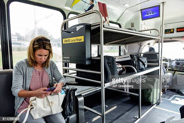 A woman sat on a shuttle bus at LambertSt Louis International Airport