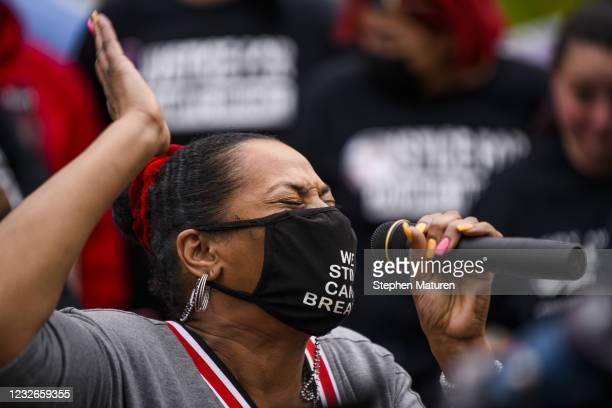 Woman says a prayer before people march to the Brooklyn Center police headquarters in honor of Daunte Wright on May 2, 2021 in Brooklyn Center,...