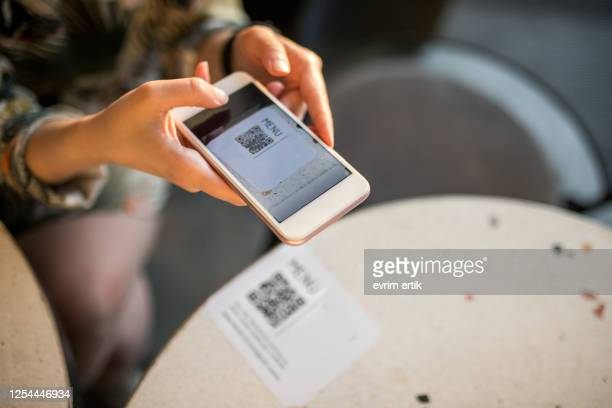 woman scanning qr code for online menu - human body part stock pictures, royalty-free photos & images