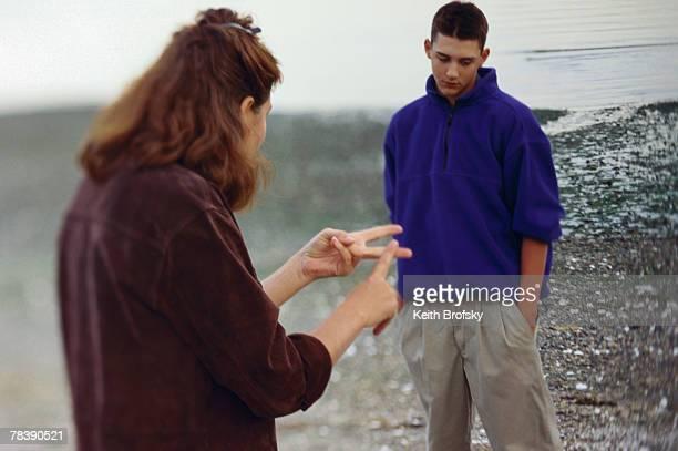 Woman scolding boy