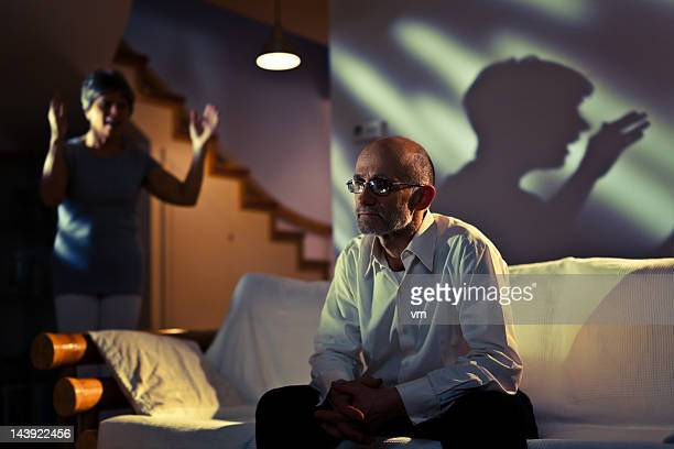 woman scolding depressed senior man - domestic violence stock pictures, royalty-free photos & images