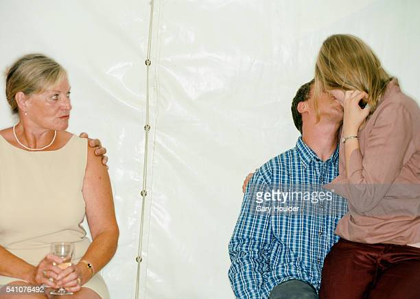 Woman Scowling at Kissing Couple