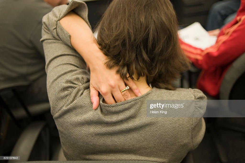 Woman Scratching Back : Stock Photo