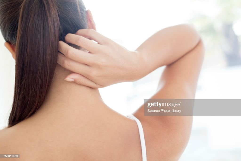 Woman scratching neck : Stock Photo