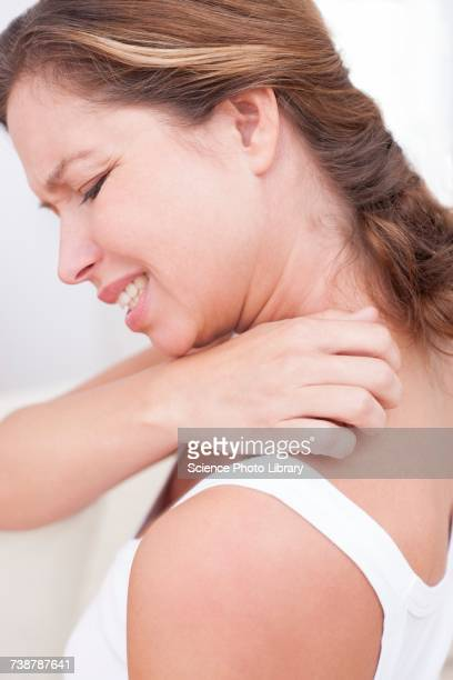 Woman scratching shoulder