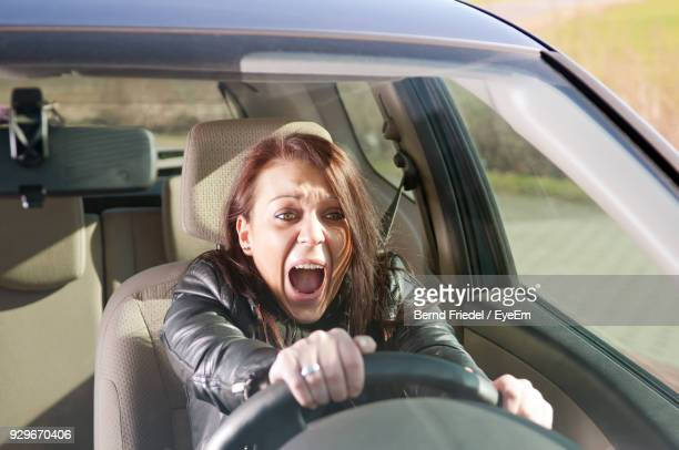 woman screaming in car - horrible car accidents stock pictures, royalty-free photos & images