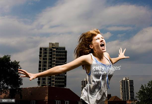 Woman screaming in city
