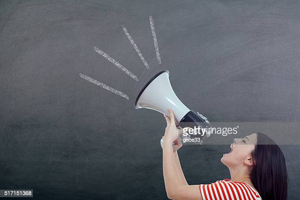 Woman Screaming in Megaphone on blackboard