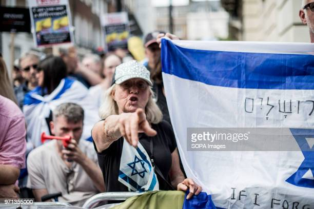 A woman screaming in the prozionist counterdemo Hundreds of antiIsrael protesters marched through the streets on the annual Al Quds Day Started by...