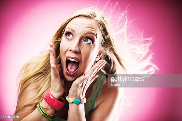 woman screaming in total shock - total look stock photos and pictures