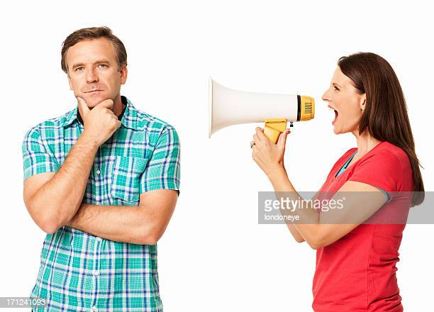Woman Screaming into Megaphone At Man - Isolated