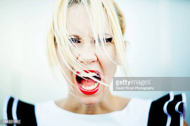 woman screaming - fury stock pictures, royalty-free photos & images