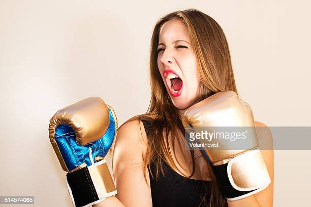 woman screaming with boxing gloves - boxing golden gloves stock photos and pictures