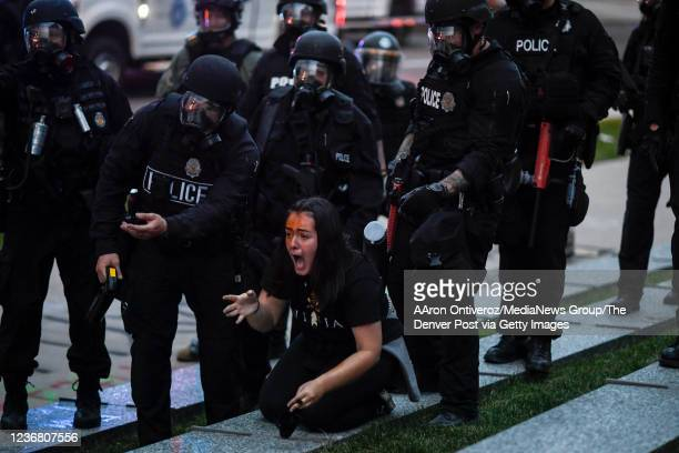 A woman screams after receiving a pointblank shot of pepper spray from advancing police during a protest after the killing of George Floyd u2013 the...