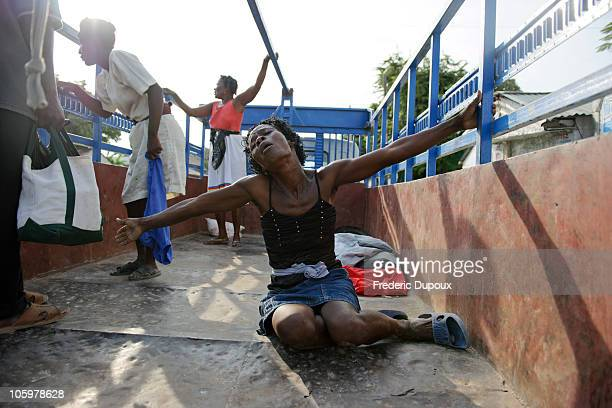 A woman screams in agony in the back of a transport truck for the loss of her husband outside of St Nicolas Hospital after a cholera outbreak hit the...
