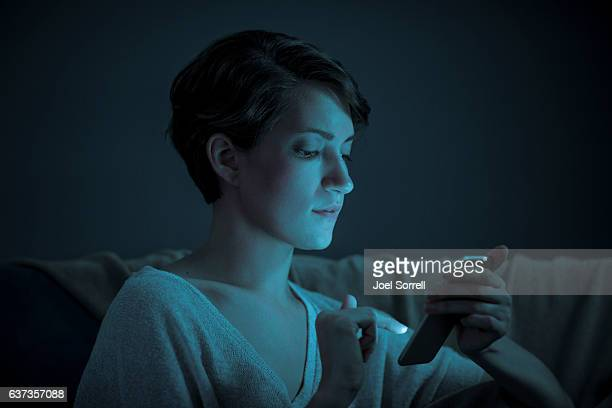 Woman Scrolling on Her Touch Screen Device