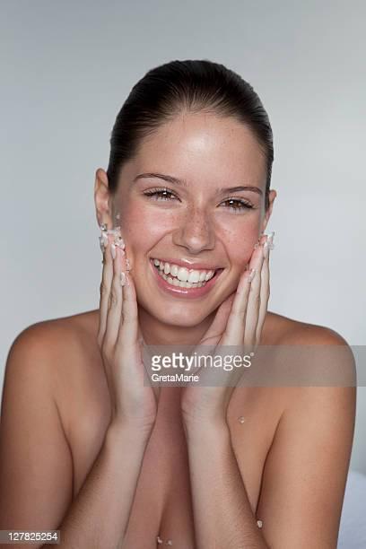 Woman scrubbing sugar on her face