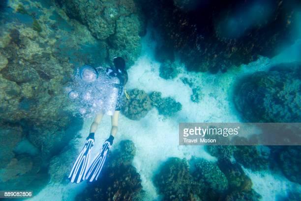 Woman scuba diver in Phuket, Thailand