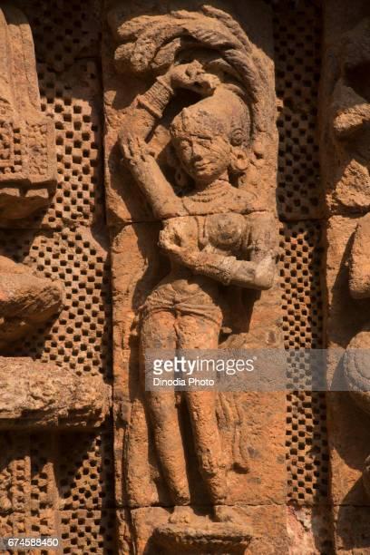 Woman sculpture, sun temple wall, konark, orissa, india, asia