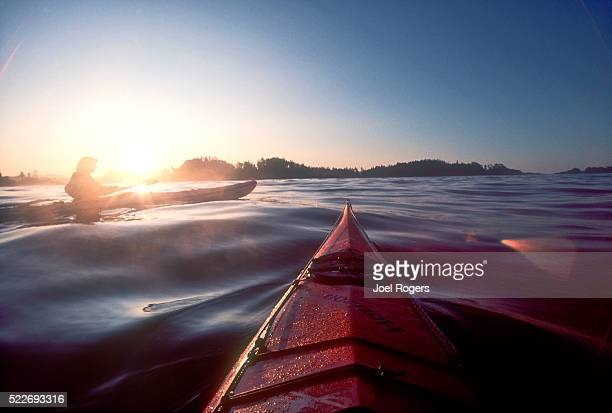 woman sea kayaking, barkley sound, vancouver island, canada - sea kayaking stock pictures, royalty-free photos & images