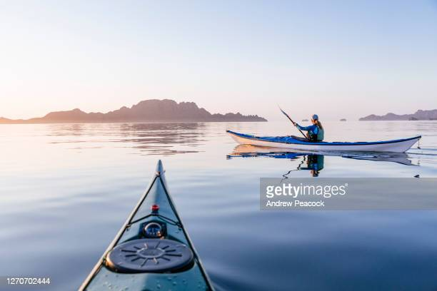 woman sea kayaking in bahia de loreto national park, puerto escondido, baja california sur, mexico - sea kayaking stock pictures, royalty-free photos & images