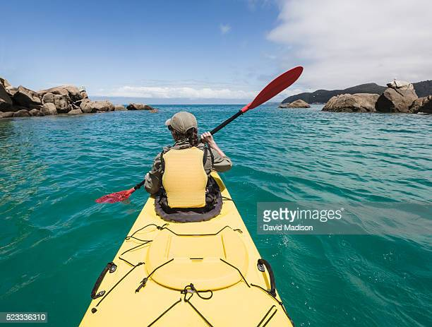 Woman sea kayaking in Shag Harbor, Abel Tasman National Park, South Island, New Zealand
