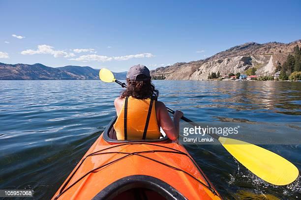 woman sea kayaking - thompson okanagan region british columbia stock pictures, royalty-free photos & images