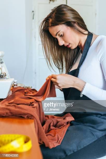 woman seamstress measuring - sewing stock pictures, royalty-free photos & images