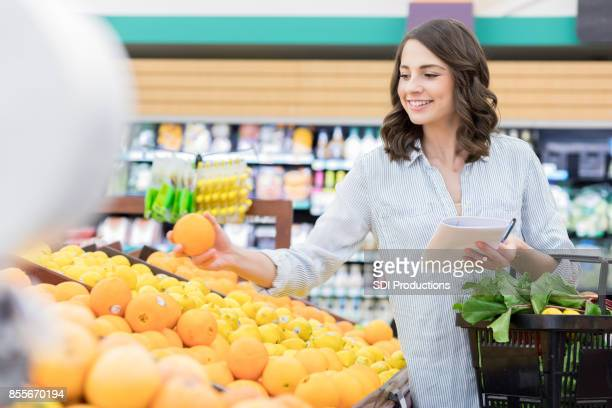 Woman searches for the perfect orange